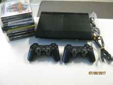 Sony Ps3 -500gb , 2 controllers and 10 games like: GTA V + Black ops 1+2, Resident evil 5,etc