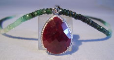 Shaded, facetted emerald necklace (43ct) with ruby solitaire pendant (16ct).