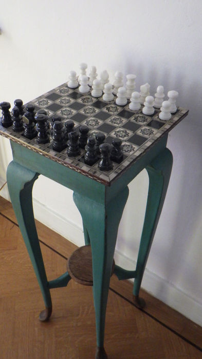 High chess table with mother of pearl inlays and marble chess pieces
