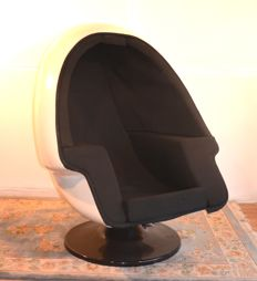Egg-shaped swivel armchair with integrated case