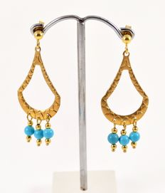 Earrings in 18 kt yellow gold with turquoises