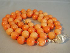 Long necklace made of large, Pacific, angel skin coral of 270ct in total.