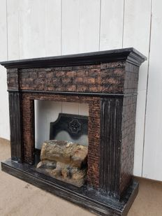 The decorative fireplace is in an excellent condition