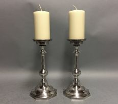 Set of identical silver plated large candle stands with thick candle, England, ca. 1925