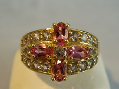 Golden ring with tested pink colour tourmalines (0.80 ct) and real tanzanites (0.57 ct)