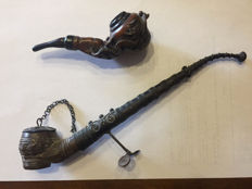 A pair of opium pipes