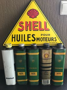 Enamel Shell sign and 5 old cans