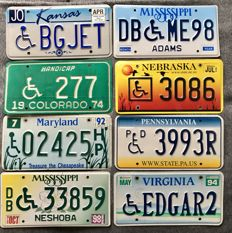 A Lot with 8 Disabled/Handicapped wheelchair driver's license plates.