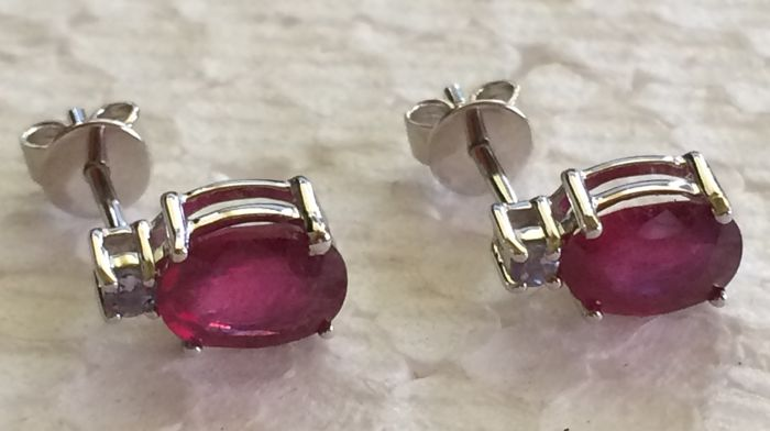 14 kt White gold  ruby earrings set with a single stone.  size 7 x 5 mm