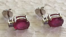 14 kt White gold  ruby earrings set with a single stone.  size 9 x 7 mm