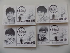 The Beatles official 1964 tie pins , on original cards.