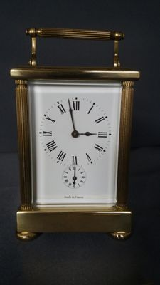 French travel clock with alarm clock.