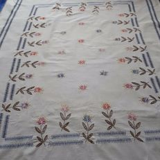 Hand coloured tablecloth with embroidery