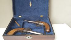 Pair percussion pistols 10mm in wooden box. (Case). Origin France.