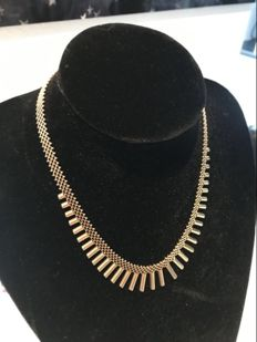 Gold women's necklace.