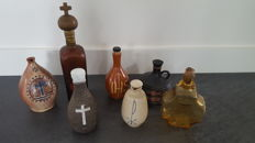 7 holy water jugs - various countries - 20th century