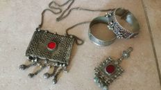 Items of jewellery from different places in the Middle East - necklace with a large pendant plus another pendant and two bracelets