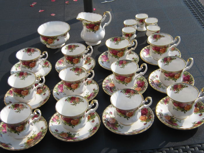 12 Royal Albert Old Country Roses cups and saucers, sugar bowl and creamer set and 5 egg cups