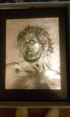 Christ carved on silver plate