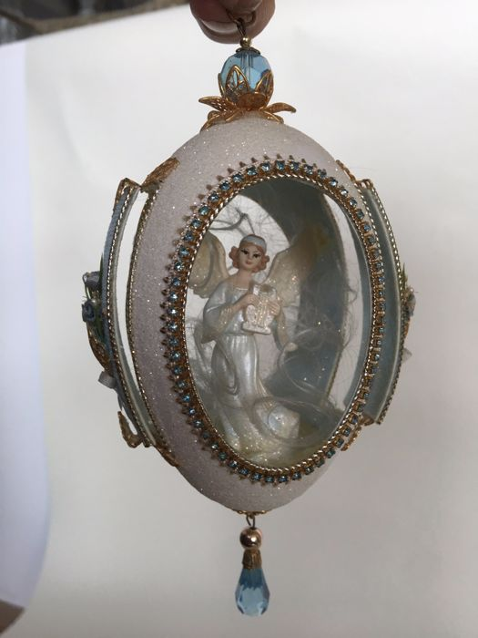Unique Christmas ornament, a detailed ornate egg decorated with crystal with an angel, made of cut-out goose egg