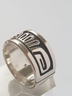 Navajo silver men's ring with very peculiar Navajo figure.