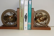 A pair of bookends with hemispheres in brass and wood - circa 1930