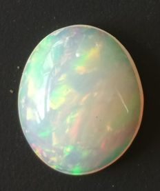 Extremely bright Ethiopian opal - 13 mm x 10.7 mm x 4.6 mm - 2.7 ct.
