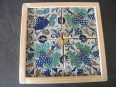 4 tiles in a tableau with bunches of grapes