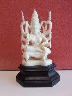 Ivory sculpture of the Hindo goddes Durga; on a wooden pedestal - India - approx. 1930