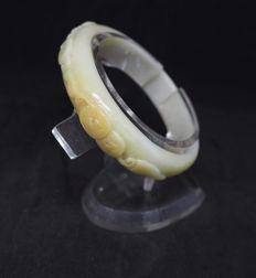 Vintage grade 'A' jadeite hand carved yellow bangle with Ruyi and coin carvings,  weight: 45.7 grams, ca: 1920's