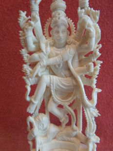 Ivory sculpture of the Hindu god Shiva; on a wooden pedestal - India - approx. 1930