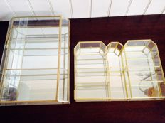 Two exclusive glass brass display cabinets