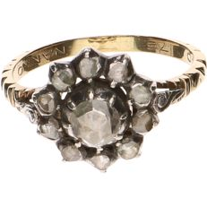 14 kt Yellow gold ring set with 11 rose cut diamonds.