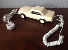 Decorative telephone in the shape of a car