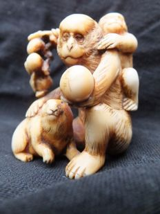 A beautiful, very fine carved ivory okinomo of two monkeys with a rabbit..Signed by the artist - Japan - ca. 1900 (late Meiji period)
