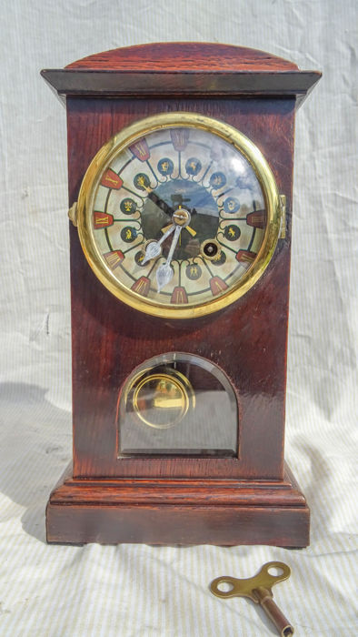 Table clock with sign of the zodiac – ca. 1950