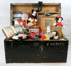 Wooden box with old toys collection