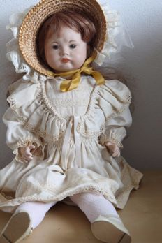 Porcelain replica doll complete with wig, hat, and shoes SFBJ 239 PARIS