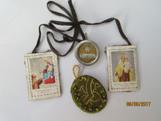 Relic of Saint Therese and two ecclesiastical pendants - Western Europe - circa 100 years old