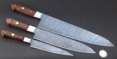 Set of three handcrafted Damask knives - 1 very long and wide chef's knife, 1 medium chef's knife, 1 fruit chef's knife - 200 + layers of damask steel - handle made from rosewood