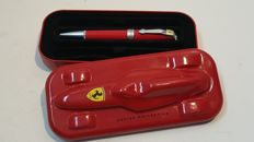 Original Ferrari pen with metal case shaped like a race car