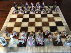 Stunning hand-painted tin chess set in chest with marble board.