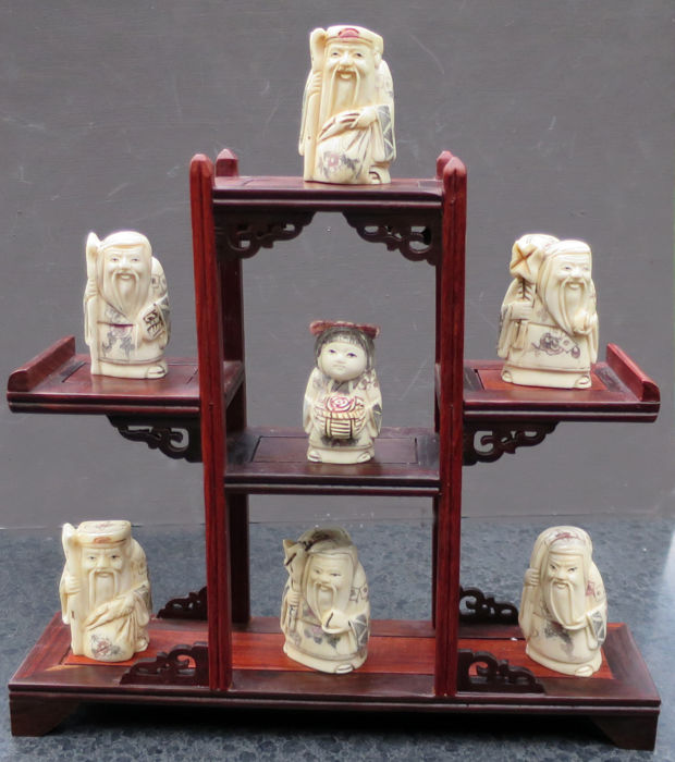 7 bone netsuke on a wooden display stand - China - end of the 20th century