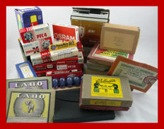 Many old glass plates / flash bulbs and beautiful classic packaging