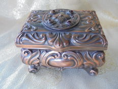 Antique copper bronze jewellery box with music in baroque style, very large with four red stones on the box.