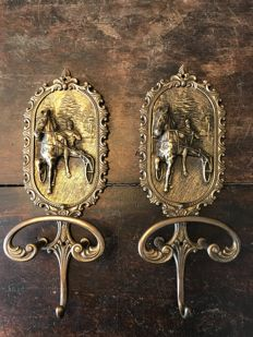 A few large brass coat rack hooks up with horse racing-horse racing theme