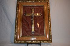 A framed crucifix with curved glass - made around 1880