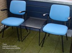 Two steel tube armchairs with matching table