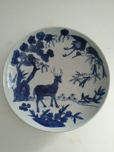Plate in blue white porcelain, with crane, deer, pine, bamboo and plum blossom decorations, China 19th century