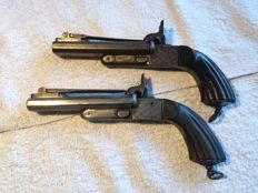 Pair 2 Shots Percussion pistols with folding Daggers in original condition and patina